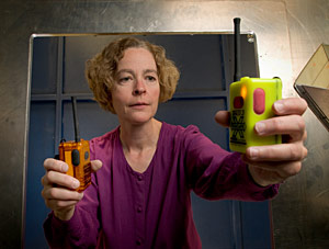 Measurements to help safeguard first responders: NIST engineer Kate Remley holds two Personal Alert Safety System (PASS) devices with wireless alarm capability. Copyright: Paul Trantow/Altitude Arts
