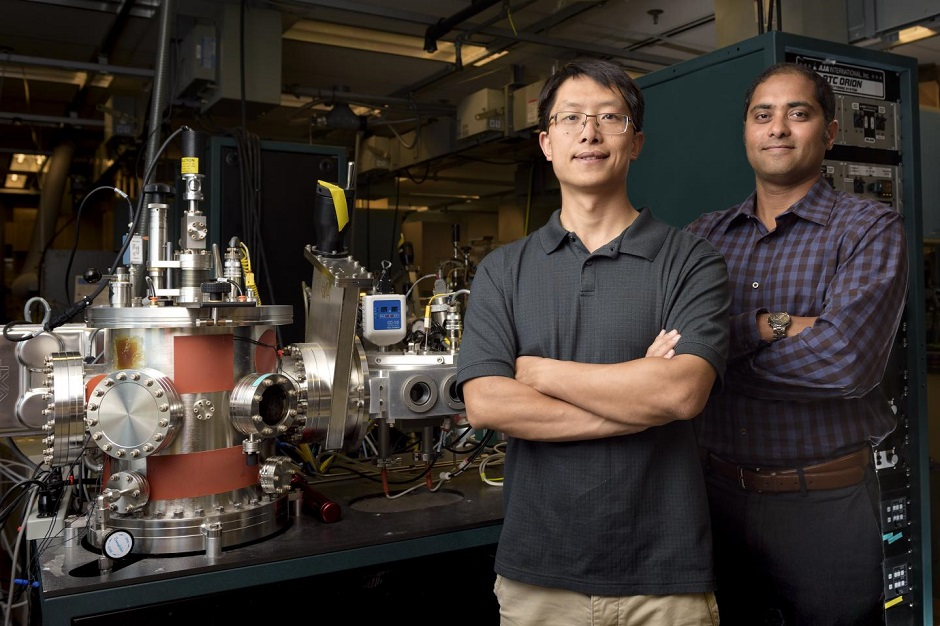 "CAPTION Purdue postdoctoral research associate Fan Zuo, at left, and materials engineering professor Shriram Ramanathan, used a ceramic ""quantum material"" to create the technology. CREDIT Rebecca Wilcox"