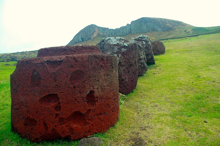 Pukao are large, cylindrical stones made from a volcanic rock known as 'red scoria.' Weighing multiple tons, they were placed on the heads of the moai during prehistoric times, consistent with the Polynesian traditions of honoring their ancestors.  CREDIT Carl LIpo