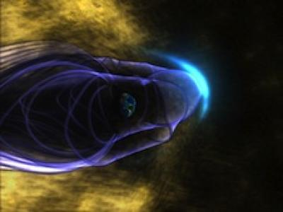 This is an artist's concept of the Earth's global magnetic field, with the bow shock. Earth is in the middle of the image, surrounded by its magnetic field, represented by purple lines. The bow shock is the blue crescent on the right. Many energetic particles in the solar wind, represented in gold, are deflected by Earth's magnetic shield. Credit: Walt Feimer (HTSI)/NASA/Goddard Space Flight Center Conceptual Image Lab