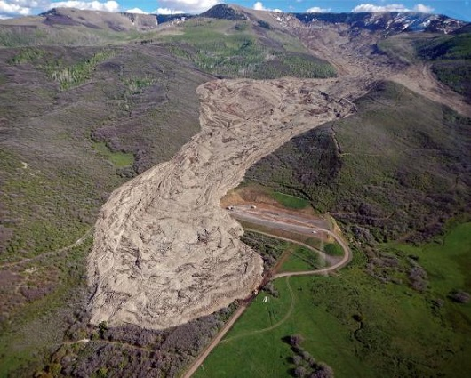 Long-runout This 1994 landslide in Mesa County, Colorado contained 30 million cubic meters or rock and ran out for 2.8 miles. New research helps explain how these large slides are able to run out so far. Jon White/Colorado Geological Survey