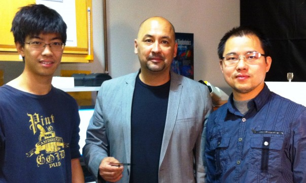 Alexander Balandin, center, stands with two of his graduate students, Guanxiong Liu (left) and Zhong Yan (right)