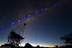 Photo showing the gamma-ray sky over Namibia, as measured by the four H.E.S.S. telescopes during the last years, superimposed onto an optical image, with one of the small H.E.S.S. telescopes in the foreground (Credit: H.E.S.S. Collaboration, Fabio Acero and Henning Gast)